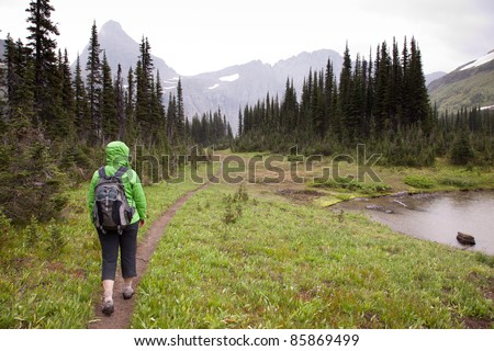 Woman Hiking Trail in Rainy Weather - stock photo