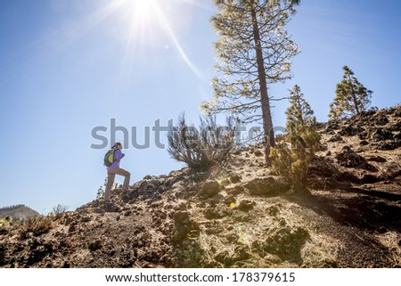 woman hiking up the mountain - stock photo