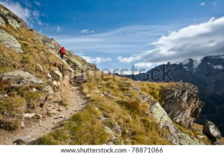 woman hiking with babycarrier and baby boy in hannig range, swiss - stock photo