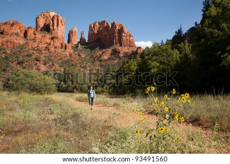Woman Hiking with Cathedral Rock in Background (Sedona, Arizona) - stock photo
