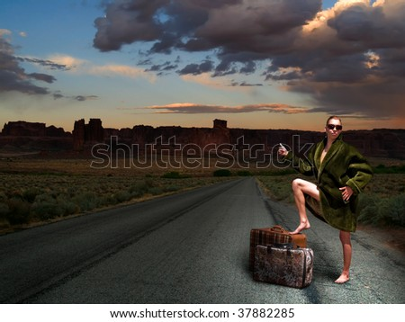 Woman hitchhiking barefoot dressed in faux fur coat