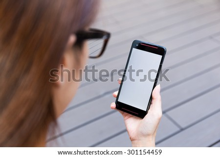 Woman hold a cellphone with blank screen - stock photo