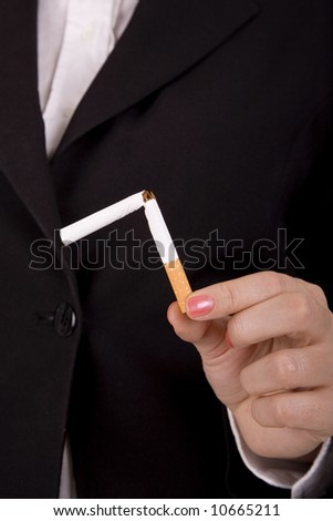 Woman hold broken cigarette.