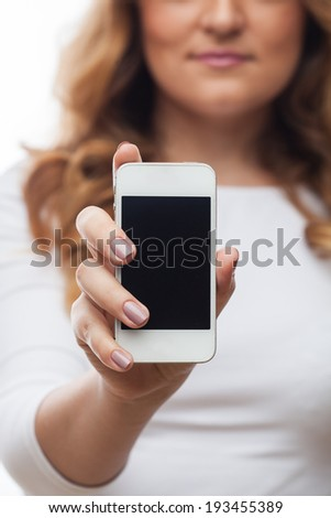 Woman hold cellphone on white background - stock photo