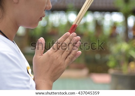 Woman Hold Incense Aroma Sticks - stock photo