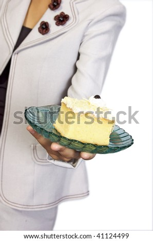 Woman hold plate of slice tart. This image shoot in the studio