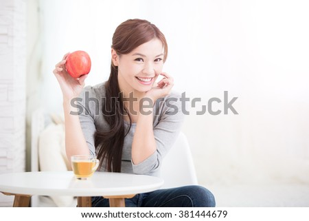 woman hold red apple at home, healthy lifestyle concept, asian beauty - stock photo