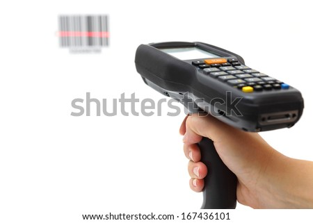 woman hold scanner and scans bar code with laser - stock photo