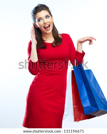 Woman hold shopping bags isolated on white background. Young Female model .