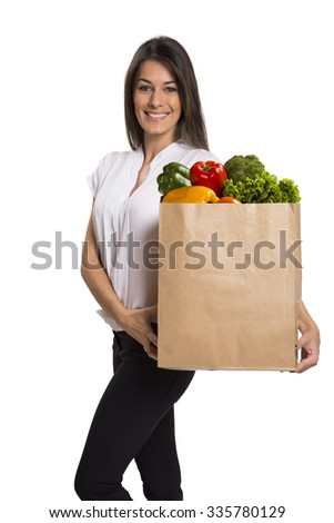 woman hold vegetables and fruits in grocery bag . food shopping . white background.