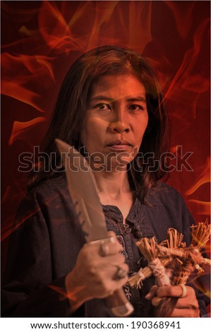 Woman hold voodoo dolls in halloween day  - stock photo