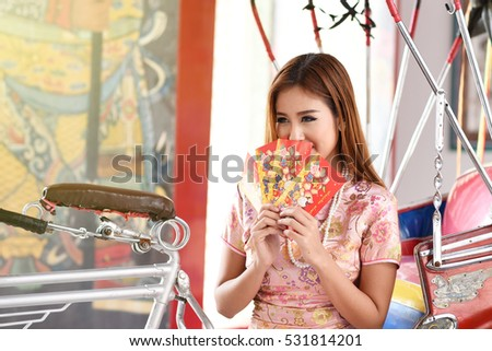 Woman hold with luck money. Asian woman hold with red pocket