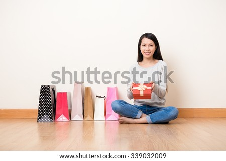 Woman hold with present box with lots of shopping bag - stock photo