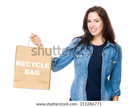 Woman hold with shopping bag for showing phrase of recycle bag