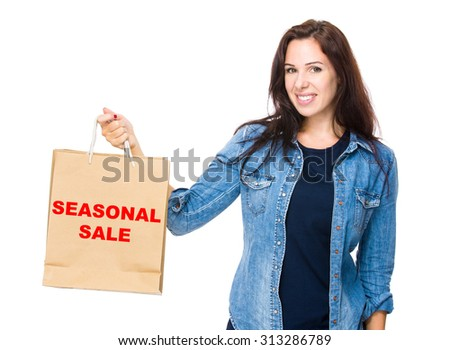 Woman hold with shopping bag for showing phrase of seasonal sale