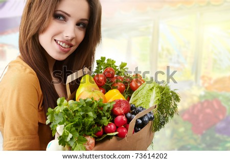 woman holding a bag full of healthy food. shopping . - stock photo
