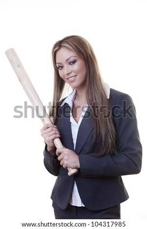 woman holding a baseball bat as if she is about to hit someone or some thing - stock photo