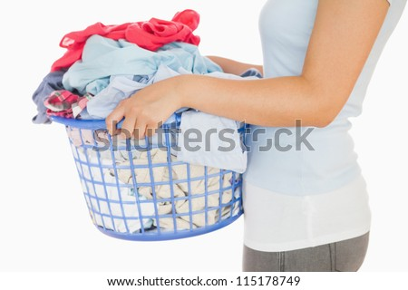 Woman holding a basket full of laundry on a white background
