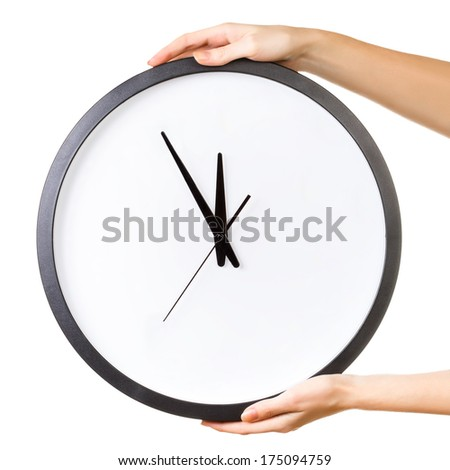 Woman holding a big clock isolated on a white background. Time concept - stock photo