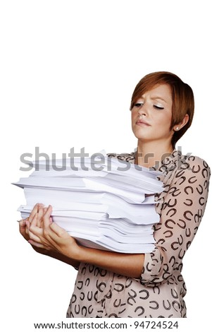 woman holding a big pile of paper work