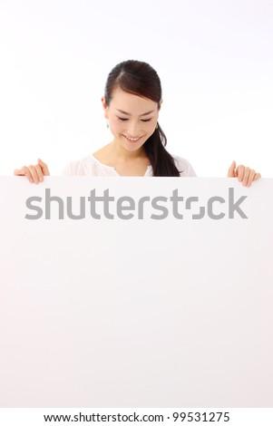 woman holding a blank billboard. - stock photo