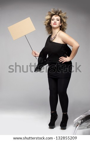 woman holding a board ready for a slogan