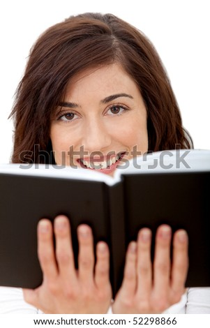 Woman holding a book isolated over a white background - stock photo