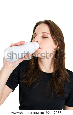 Woman Holding A Bottle Of Lactose Free Milk And Smiling And Doing A Thumb Up - stock photo