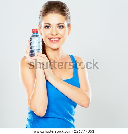 woman holding a bottle of water in front of him. studio portrait on isolated background . - stock photo