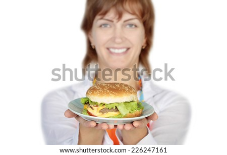 woman holding a burger
