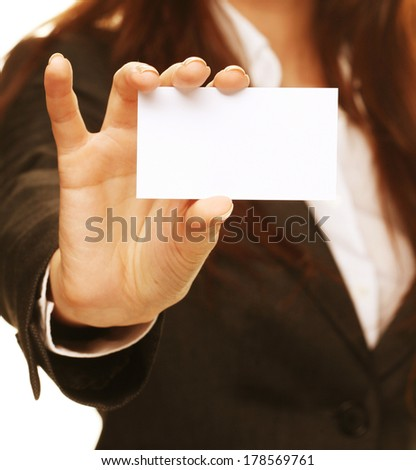 woman holding a business card and smiling
