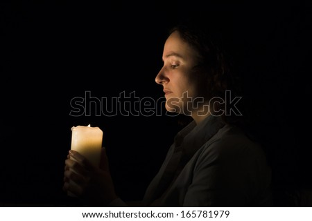 woman holding a candlelight in her hands