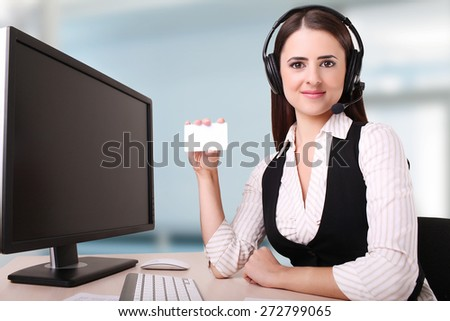 Woman holding a card to include contact detail  - stock photo