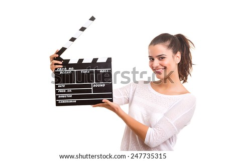 Woman holding a clapboard isolated over white background - stock photo