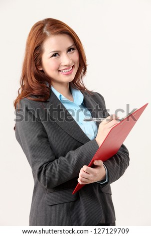 woman holding a clip board - stock photo