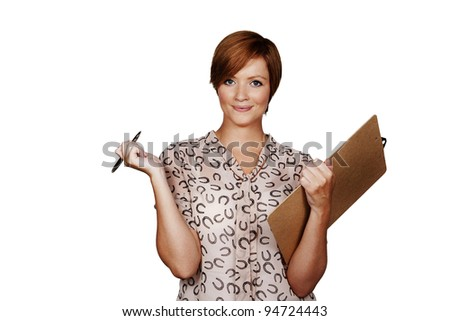 woman holding a clip board shot in the studio - stock photo