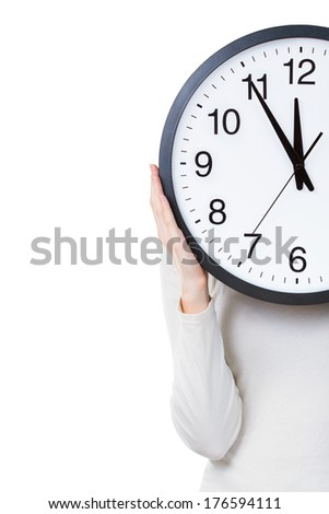 Woman holding a clock isolated on a white background with copy space. Time concept - stock photo