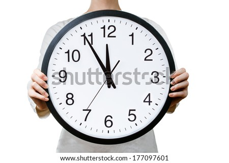 Woman holding a clock. Time management concept - stock photo