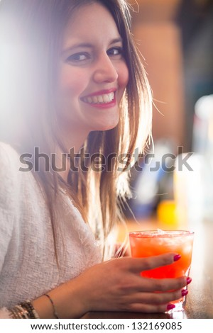 Woman holding a cocktail glass - stock photo