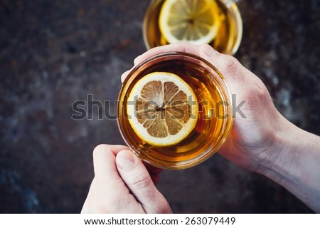 Woman Holding A Cup Of Hot Tea - stock photo