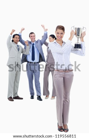 Woman holding a cup with people dressed in suits acclaiming in background - stock photo
