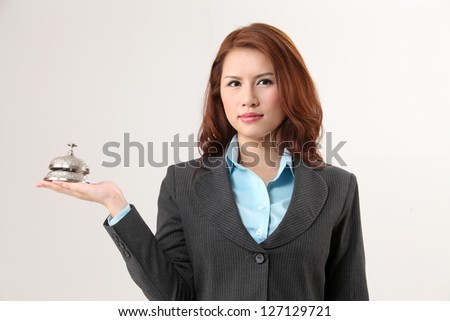woman holding a desk bell