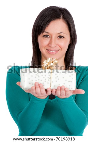 Woman holding a gift - isolated over a white background