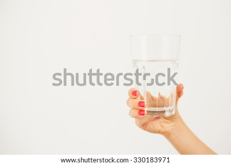 Woman holding a glass of water  - stock photo
