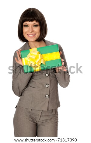 Woman holding a green box with yellow bow as a present - stock photo