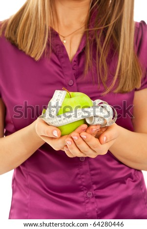 Woman holding a green juicy apple