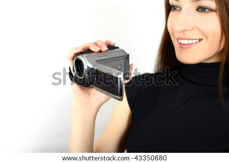 woman holding a home video camera - stock photo