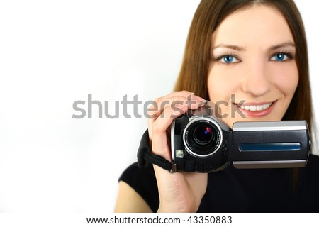 woman holding a home video camera