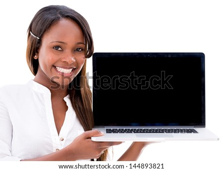 Woman holding a laptop displaying the screen - isolated over white - stock photo