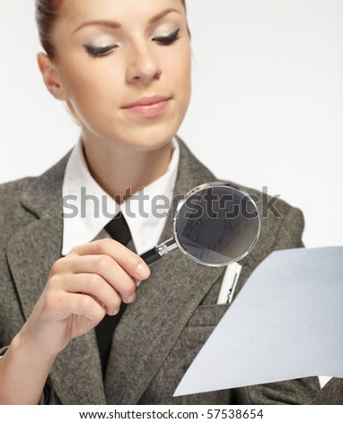 woman holding a magnifying glass in the hand - stock photo